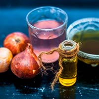5 Astonishing Benefits Of Red Onion Hair Oil For Lustrous And Stronger Mane