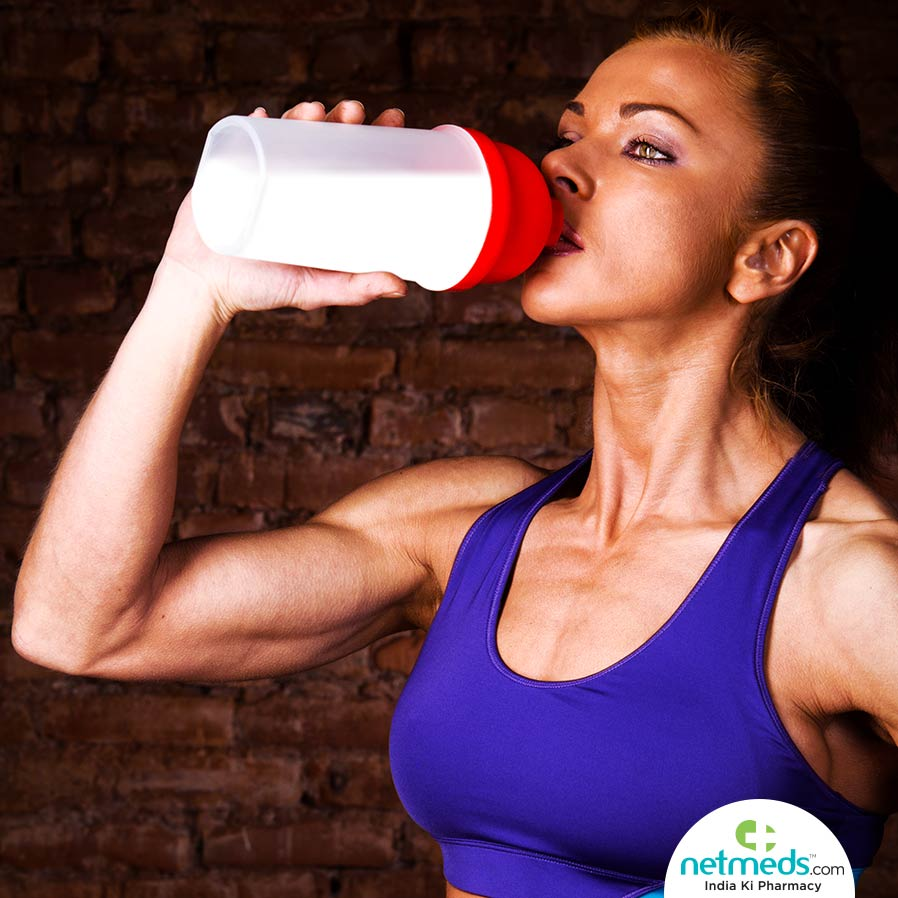 Woman Drinking Protein Supplement