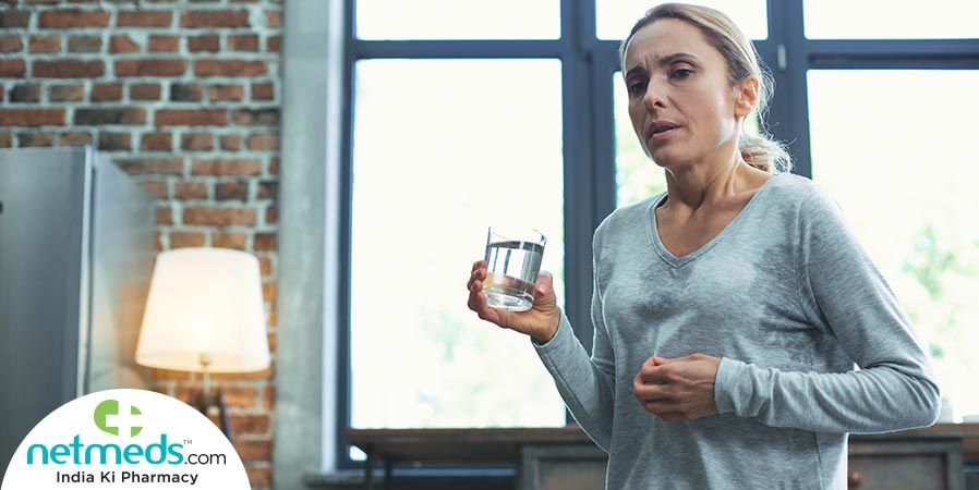 Woman drinking water for hot flashes